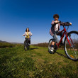 Girl and boy riding bikes — Stock Photo