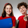 Girl and boy showing OK sign — Stock Photo