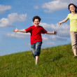 Girl and boy running, jumping outdoor — Stock Photo #9521375