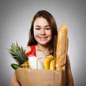 Girl holding shopping bag — Stok fotoğraf