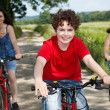 Family riding bikes — Stockfoto #9657129