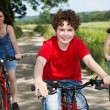 Family riding bikes — Stock Photo #9657129