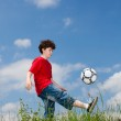 Boy playing football outdoor — Stock Photo #9657386