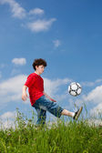 Boy playing football outdoor — Stock Photo