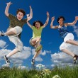 Active family - mother and kids jumping outdoor — Stock Photo #9670676