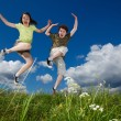 Girl and boy running, jumping outdoor — Stock Photo #9670702