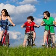 Family riding bikes — Stock Photo #9670907