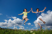 Active family - mother and kid running, jumping outdoor — Stock Photo