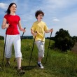 Nordic walking - mother and son outdoor — Stock Photo #9682839