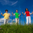 Nordic walking - active family outdoor — Stock Photo #9682894