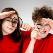 Stock Photo: Girl and boy holding magnifying glass