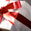 Gift with red tapes and bows — Stock Photo #10514282