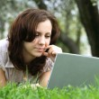 The girl with laptop on the nature - Stock Photo
