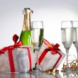 Glasses of champagne, gifts with red tapes and bows - Foto de Stock