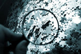 Magnifying glass, puzzle — Stockfoto