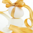 Easter egg with a bow golden — Stock Photo #10554616
