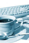 Cup of coffee at office — Stock Photo