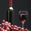Bottle and glass of wine, grapes — Stock Photo