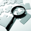 Magnifying glass, puzzle — Stock Photo