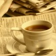 Cup coffee on a morning paper business news — Stock Photo