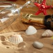 Champagne sparkling on a beach — Stock Photo