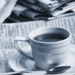 Cup  coffee on a morning paper business news — Стоковая фотография