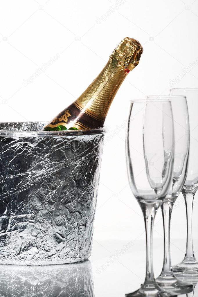 Champagne flutes and ice bucket — Stock Photo #10644618