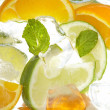 Leaf mint and cut citrus in ice — Stock Photo #10670366