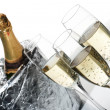 Champagne flutes and ice bucket - Stock Photo