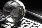 Globe and keyboard — Stock Photo