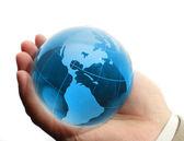 Wereld in de hand en global internet en zakelijke — Stockfoto