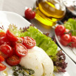 Tomatoes with mozzarella — Stock Photo #9039153