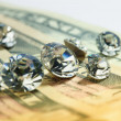 Diamonds and money — Stock Photo