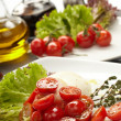 Tomatoes with mozzarella — Stock Photo #9041718