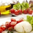 Tomatoes with mozzarella — Stock Photo #9042247