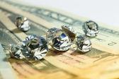 Diamonds and money — Stock Photo