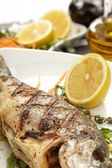Fish with lemon — Stock Photo