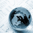 Stock Photo: Globe on business documents