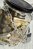 Coins in money jar — Stock Photo