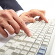 Stock Photo: Hands on keyboard