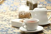 Cup of tea with a teapot — Stock Photo