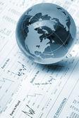 Globe on business documents — Stock Photo