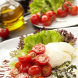 Tomatoes with mozzarella — Stock Photo #9150900