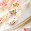 Golden rings and rose petals — Stock Photo