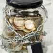 Coins in money jar — Stock Photo