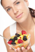 Woman eating fruit salad — Stock Photo