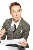 Woman holding a magnifying glass in the hand — Stock Photo