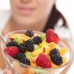 Woman eating fruit salad — Stock Photo #9253916