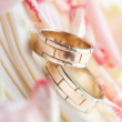 Golden rings and rose petals — Stock Photo #9254507