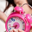 Beautiful woman sleeping and alarm clock — Stock Photo